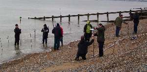 Birkbeck College surveying the beach as the tide comes in
