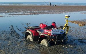 Quad bike stuck in soft mud