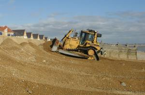 Bulldozer reprofiling cliff east of Sovereign Harbour