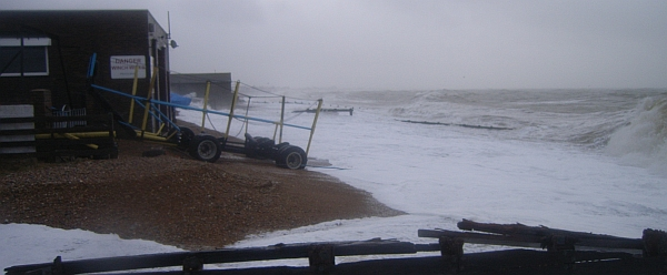 Waves attacking the two boat houses at Grey Towers, Pevensey Bay